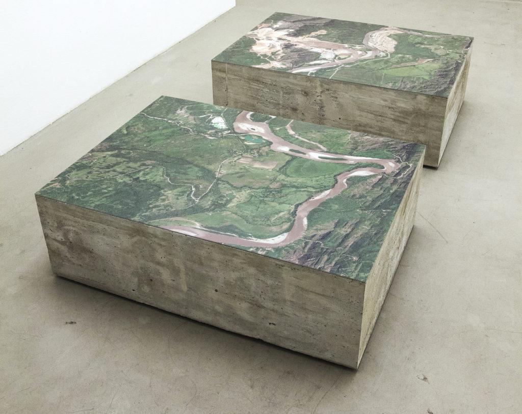 Carolina Caycedo Dammed Landscape / Paisaje Respresado, 2013, Satellite images and concrete. 110x85x40 cm (each) Courtesy of Instituto de Visión. Image: Installation at DAAD Gallery Berlin.